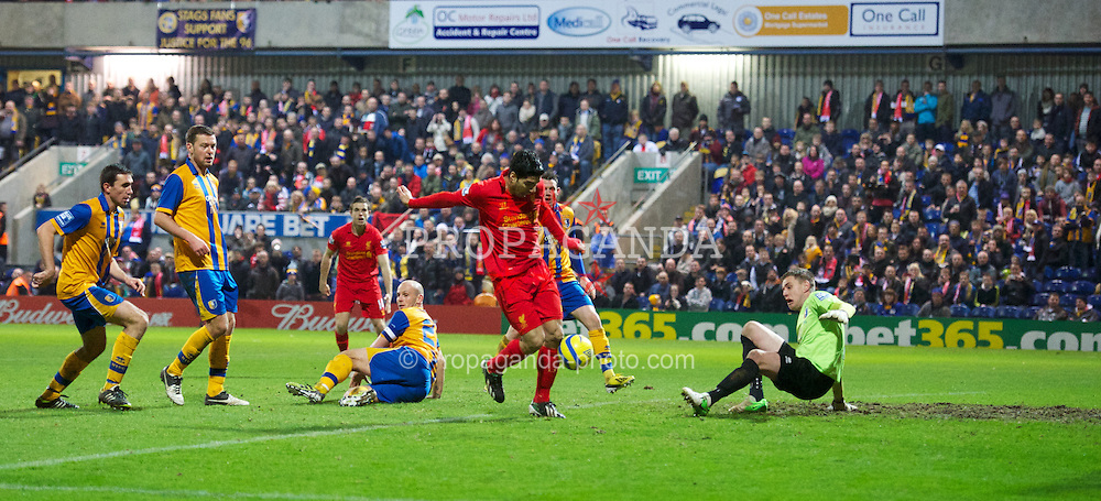 MANSFIELD, ENGLAND - Sunday, January 6, 2013: Liverpool's Luis Alberto Suarez Diaz scores the second goal against Mansfield Town, with the ball hitting his right arm, but no hand-ball was given as the referee deemed it not deliberate, during the FA Cup 3rd Round match at Field Mill. (Pic by David Rawcliffe/Propaganda)