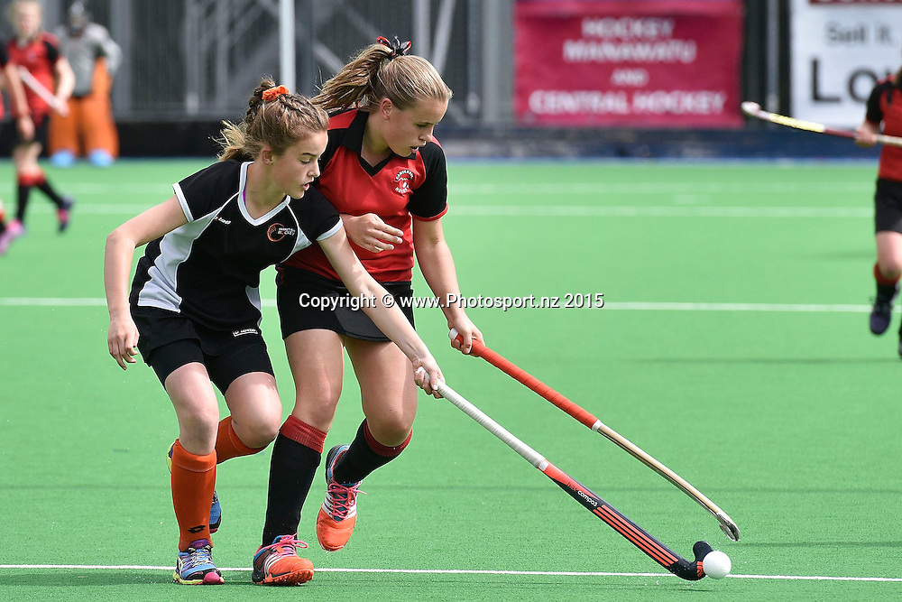 Sarah-Kate Birkett (L) of Hawkes Bay fights for possession with Alesha Davis of Canterbury during the Canterbury vs Hawkes Bay Collier Trophy U13 Girls Hockey Final at the Manawatu Hockey Stadium in Palmerston North on Saturday the 10 October 2015. Copyright photo by Marty Melville / www.Photosport.nz