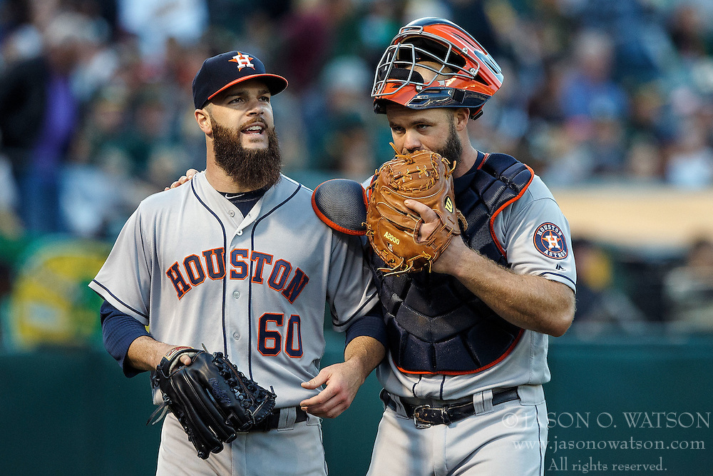 OAKLAND, CA - JULY 19:  Evan Gattis #11 of the Houston Astros is congratulated by Dallas Keuchel #60 after tagging out Marcus Semien (not pictured) of the Oakland Athletics at home plate during the second inning at the Oakland Coliseum on July 19, 2016 in Oakland, California. (Photo by Jason O. Watson/Getty Images) *** Local Caption *** Evan Gattis; Dallas Keuchel