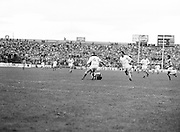 An Armagh player stands over a Roscommon player who was tackled to the ground during the All Ireland Senior Gaelic Football Semi Final Replay Roscommon v Armagh in Croke Park on the 28th August 1977. Armagh 0-15 Roscommon 0-14.