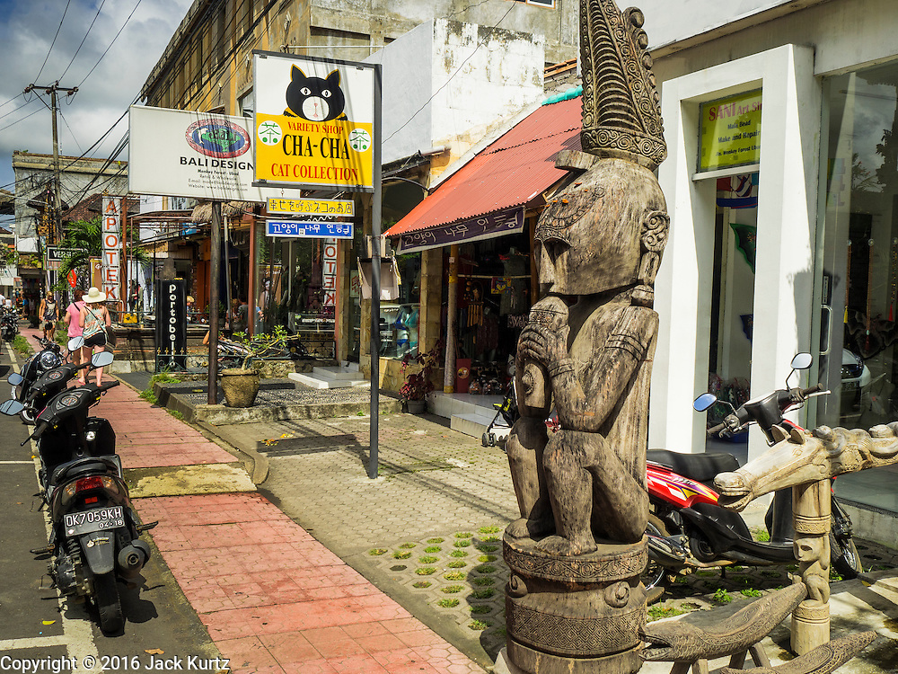17 JULY 2016 - UBUD, BALI, INDONESIA: Storefronts on Jalan Wenara Wana, also known as Monkey Forest Road, in Ubud, Bali.       PHOTO BY JACK KURTZ
