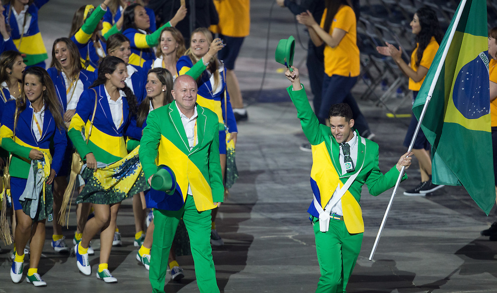 Members of the Brazil's team wave to the crowd during the opening ceremonies at the Pan American Games in Toronto, Canada, July 10,  2015.  AFP PHOTO/GEOFF ROBINS