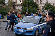 Rome, Italy. 5th January 2016<br /> Plain clothed policemen, arrest a demonstrator during a protest against evictions in Rome's Fori Imperiali . The police arrested 18 protesters.