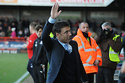 Dean Saunders waves to his new fans before the Sky Bet League 1 match between Crawley Town and Colchester United at Broadfield Stadium, Crawley, England on 28 December 2014. Photo by Michael Hulf.
