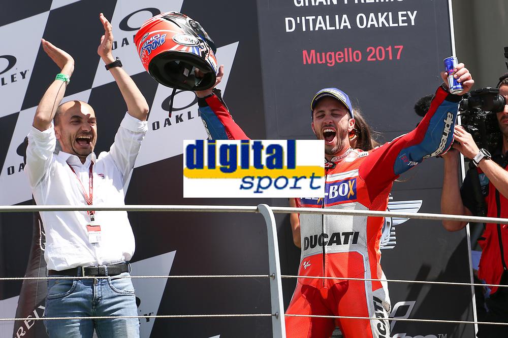 Ducati's Team rider Italian Andrea Dovizioso, winner the Moto GP Grand Prix at the Mugello race track on June 4, 2017 and Claudio Dominicali celebrates on the podium. <br /> MotoGP Italy Grand Prix 2017 at Autodromo del Mugello, Florence, Italy on 4th June 2017. <br /> Photo by Danilo D'Auria.<br /> <br /> Danilo D'Auria/UK Sports Pics Ltd/Alterphotos
