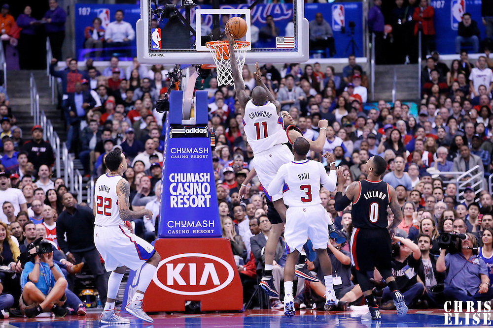 12 February 2014: Los Angeles Clippers shooting guard Jamal Crawford (11) goes for the layup over Portland Trail Blazers small forward Nicolas Batum (88) during the Los Angeles Clippers 122-117 victory over the Portland Trail Blazers at the Staples Center, Los Angeles, California, USA.