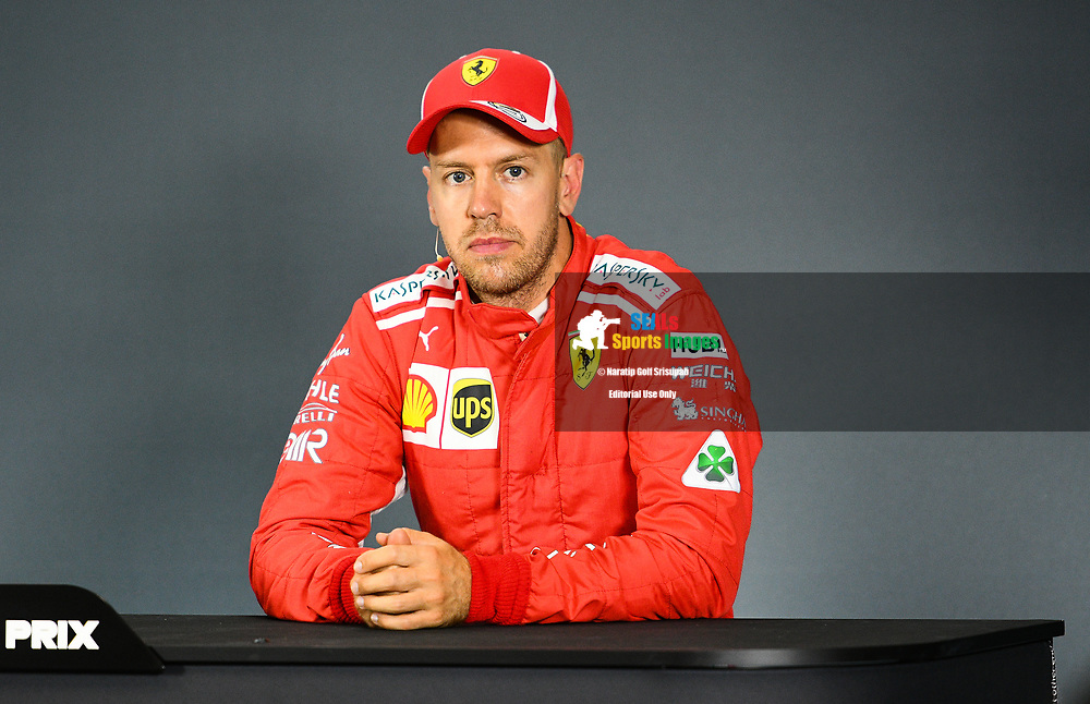 SINGAPORE - SEPTEMBER 15: Sebastian Vettel (5) of Scuderia Ferrari  during Qualifying Driver Press Conference at the F1 Singapore Grand Prix 2018, Marina Bay Street Circuit, Singapore on September 15, 2018. <br /> .<br /> .<br /> .<br /> (Photo by: Naratip Golf Srisupab/SEALs Sports Images)<br /> .<br /> Any image use must include a mandatory credit line adjacent to the content which should read: Naratip Golf Srisupab/SEALs Sports Images