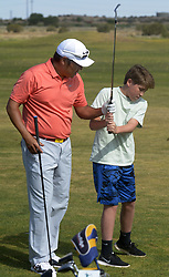 July 2, 2018 - U.S. - SPORTS -- Notah Begay III gives swing pointers to Karson Glass, 13, of Edmond, Oklahoma at the Santa Ana Golf Course during a clinic of the New Mexico Grande Slam, a golf charity event that raises money for New Mexico's children, on Monday, July 2, 2018. (Credit Image: © Greg Sorber/Albuquerque Journal via ZUMA Wire)