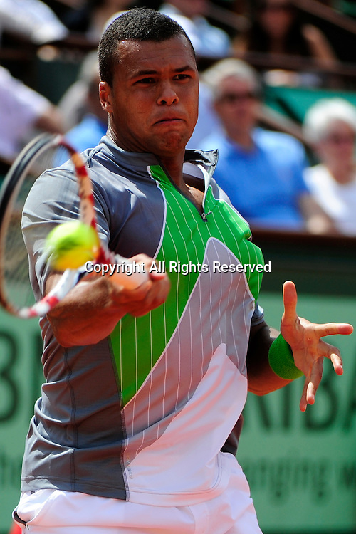 22.05.2011 French Open Tennis from Roland Garros Paris. Jo-Wilfried Tsonga of France returns a shot in his match against Jan Hajek of the Czech Republic on day one of the French Open tennis championships. The match was won by Tsonga 6-3, 6-2, 6-2.