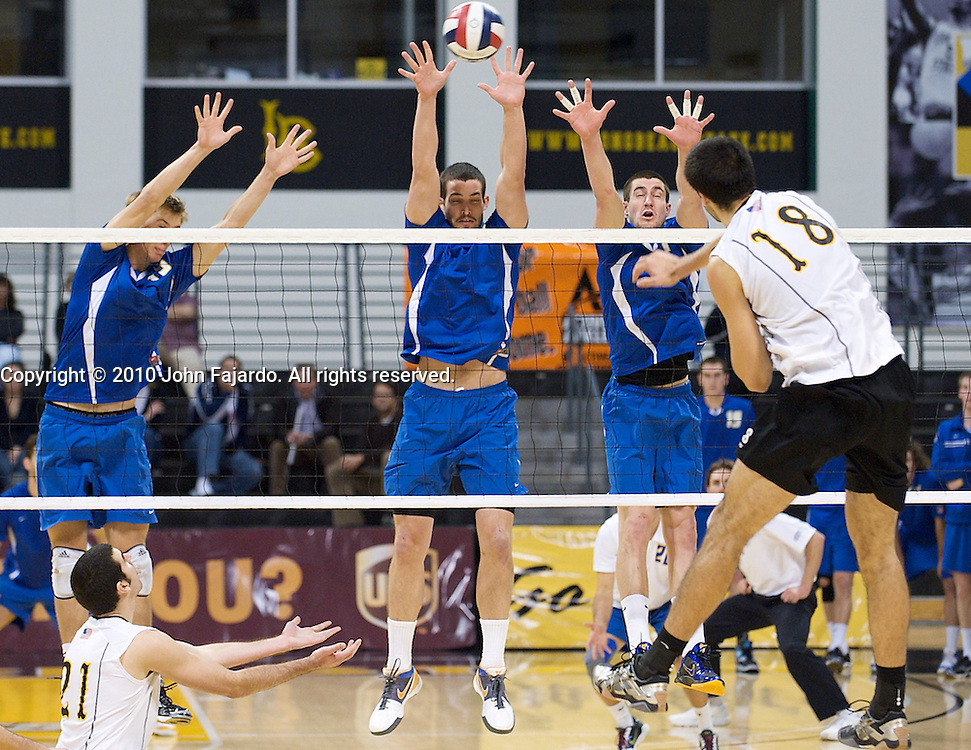 Dean Bittner(18) hits at the block in the Big West Conference match against U.C. Santa Barbara at the Walter Pyramid, Long Beach CA, Friday Feb. 12, 2010.