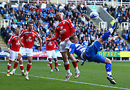 Simon Church (18) of Reading tries an overhead kick as Bobby Hassell (2) of Barnsley takes avoiding action during the Npower Championship match between Reading and Barnsley on Saturday 25th September 2010 at the Madejski Stadium, Reading, UK. (Photo by Andrew Tobin/Focus Images)