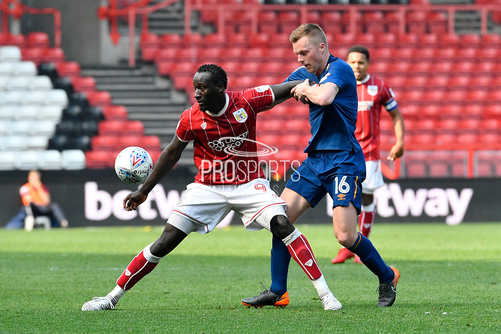 Famara Diedhiou (9) of Bristol City holds off Sebastian Larsson (16) of Hull City during the EFL Sky Bet Championship match between Bristol City and Hull City at Ashton Gate, Bristol, England on 21 April 2018. Picture by Graham Hunt.