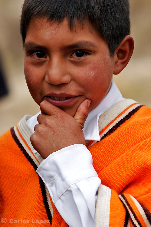 A BOY FROM THE TOWN OF LAMUD IN THE NORTHEN ANDES WEARING TRADITIONAL CLOTHES POSE FOR THE CAMERA