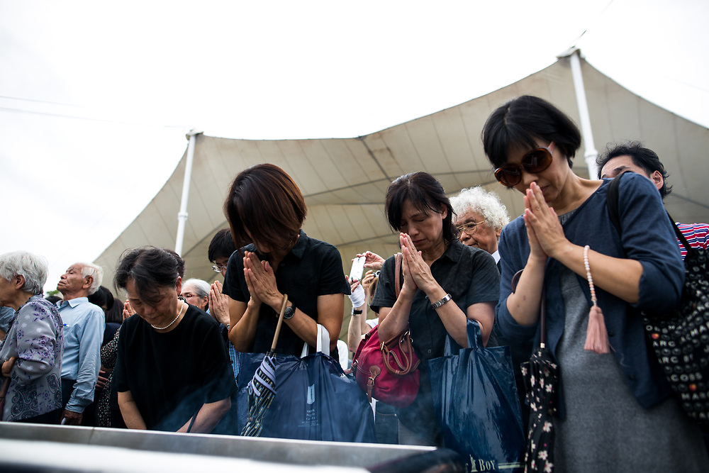 NAGASAKI, JAPAN - AUGUST 9 : Visitors lays flowers and pray for the atomic bomb victims in front of the Nagasaki Peace Park in Nagasaki, southern Japan on Wednesday, August 9, 2017. Japan marked the 72nd anniversary of the atomic bombing on Nagasaki. (Photo: Richard Atrero de Guzman/NUR Photo)