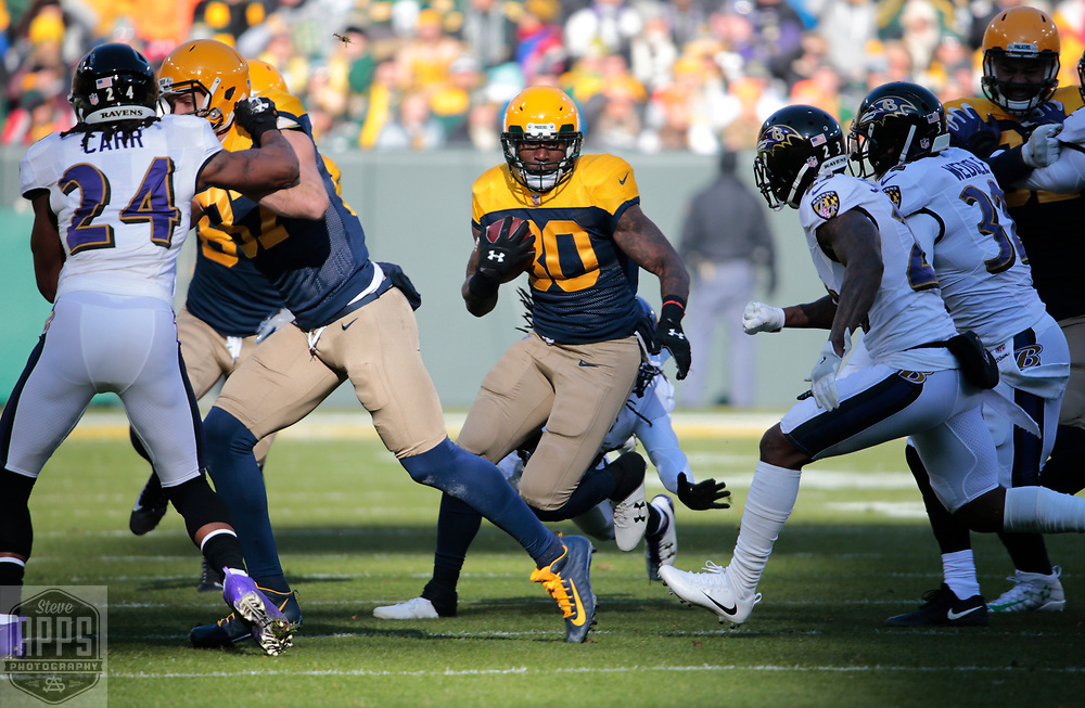 Green Bay Packers running back Jamaal Williams (30) rushes for 8-yards in the 1st quarter. <br /> The Green Bay Packers hosted the Baltimore Ravens at Lambeau Field Sunday, Nov. 19, 2017. STEVE APPS FOR THE STATE JOURNAL.