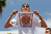 21 June 2010: Sasha Vujacic of the Los Angeles Lakers holds up his championship t-shirt during the Lakers Championship Victory Parade on Figueroa BL. in Los Angeles, CA after the Lakers won the 2010 NBA Championship over the Boston Celtics in Game 7 of the NBA Finals.