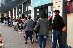 © Licensed to London News Pictures. 25/04/2020. London, UK. Shoppers observe social distancing rules as they queue in Tottenham Hale Retail Park, north London during the coronavirus lockdown. The lockdown continues to slow the spread of COVID-19 and reduce pressure on the NHS.  Photo credit: Dinendra Haria/LNP