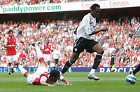 Photo: Steve Bond.<br />Arsenal v Derby County. The FA Barclays Premiership. 22/09/2007. Theo Walcott (L) is sent crashing by Claude davis. No foul.