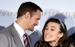 Alexander Skarsgard and Keira Knightley share a joke during the world premiere of The Aftermath, held at the Picturehouse Central Cinema, London