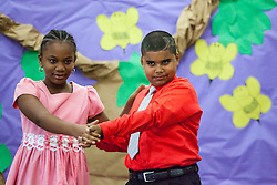 Jireh Mathurin, left, and dance partner Joshua Calcano demonstrate the Tango at the Claude O. Markoe Elementary School Dancing Classrooms VI Culminating Event.  17 December 2015.  Christiansted, St. Croix.   © Aisha-Zakiya Boyd.