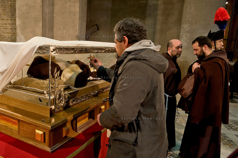 Rome, Italy. 3th Febraury 2016<br /> Pictured: Devotee in prayer before the relic of St. Leopold Mandic.<br /> The relic of St. Leopold Mandic, from Padua in the Basilica of San Lorenzo Fuori le mura awaiting the arrival of St. Pio of Pietrelcina. The two Saints were called to Rome by Pope Francis as symbols of the Mercy Jubilee.