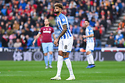 Philip Billing of Huddersfield Town (8) puffs out his cheeks in action during the Premier League match between Huddersfield Town and West Ham United at the John Smiths Stadium, Huddersfield, England on 10 November 2018.