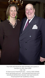 The HON.NICHOLAS & MRS SOAMES at a party in London on 29th April 2002.<br />