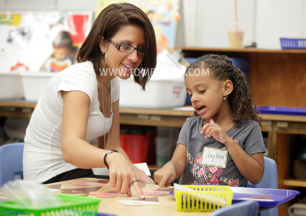 """Meghan Smith, left, helps her daughter Jaylen Jones during """"Bring Your Kids to Kindergarten Day"""" at Chorley Elementary School in Middletown on Thursday, Sept. 6, 2012. This was the final first day of school at Chorley because teachers and students will move into the new Presidential Park Elementary School when that building is finished later this school year."""