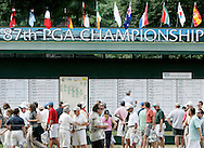 Spectators look over the leaderboard during the first round of the 2005 PGA Championship at Baltusrol Golf Club in Springfield, New Jersey, Thursday 11 August 2005. the tournement is taking place through 14 August.