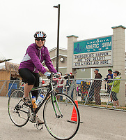 "Devitt Liptak heads out onto the 15 mile bike course around Paugus Bay for the ""Take the Bay Challenge"" during Saturday's WOW Fest event at Laconia Athletic and Swim Club.  (Karen Bobotas/for the Laconia Daily Sun)"