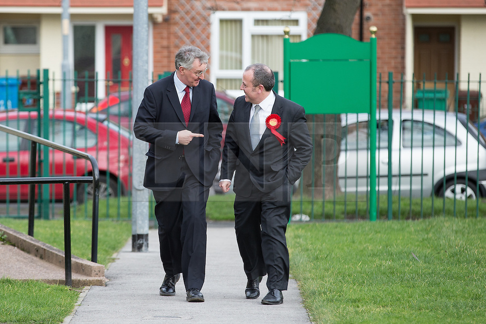 © Licensed to London News Pictures . 03/02/2014 . Manchester , UK . L-R Hilary Benn and Mike Kane arrive for the meeting . Hilary Benn , MP for Leeds Central and Shadow Community Secretary for the Labour Party , joins Labour candidate Mike Kane on the campaign trail ahead of the Wythenshawe and Sale East by-election , following the death of MP Paul Goggins . The pair speak to local pensioners about communities and housing . Photo credit : Joel Goodman/LNP