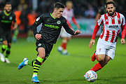 Forest Green Rovers Jack Aitchison(29), on loan from Celtic takes on Cheltenham Town's Chris Clements(8) during the EFL Sky Bet League 2 match between Cheltenham Town and Forest Green Rovers at Jonny Rocks Stadium, Cheltenham, England on 2 November 2019.