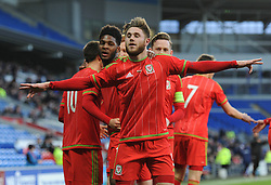 Wes Burns of Wales u21s (Bristol City) celebrates after setting up a goal for Tom O'Sullivan - Photo mandatory by-line: Dougie Allward/JMP - Mobile: 07966 386802 - 31/03/2015 - SPORT - Football - Cardiff - Cardiff City Stadium - Wales v Bulgaria - U21s International Friendly