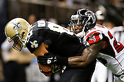 NEW ORLEANS, LA - NOVEMBER 11:  William Moore #25 of the Atlanta Falcons tackles Jimmy Graham #80 of the New Orleans Saints at Mercedes-Benz Superdome on November 11, 2012 in New Orleans, Louisiana.  The Saints defeated the Falcons 31-27.  (Photo by Wesley Hitt/Getty Images) *** Local Caption *** William Moore; Jimmy Graham