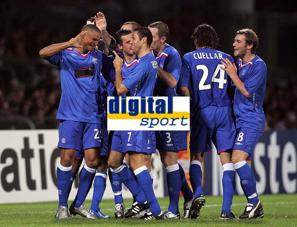 Photo: Paul Thomas.<br /> Lyon v Rangers. UEFA Champions League, Group E. 02/10/2007.<br /> <br /> Striker Daniel Cousins (L) and Rangers celebrate his wonder goal.