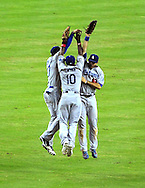 Aug. 6 2011; Phoenix, AZ, USA; Los Angeles Dodgers outfielders Matt Kemp (left) , Tony Gwynn (center) , Andre Ethier (right) celebrate after defeating the Arizona Diamondbacks 5-3 at Chase Field. Mandatory Credit: Jennifer Stewart-US PRESSWIRE..