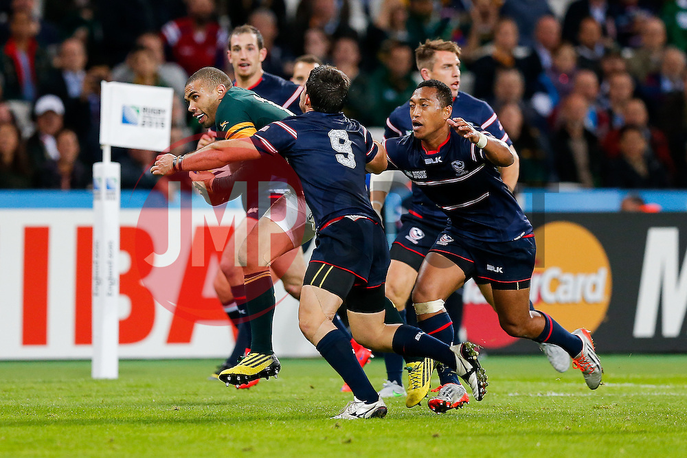 South Africa Winger Bryan Habana is tackled by USA Scrum-Half Niku Kruger - Mandatory byline: Rogan Thomson/JMP - 07966 386802 - 07/10/2015 - RUGBY UNION - The Stadium, Queen Elizabeth Olympic Park - London, England - South Africa v USA - Rugby World Cup 2015 Pool B.