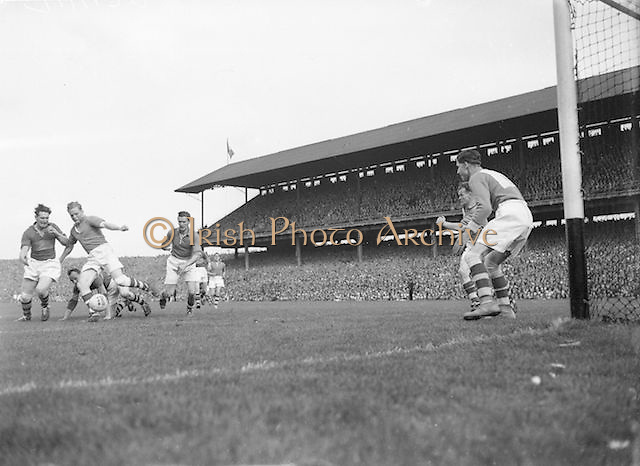 Armagh attempts to kick the ball away from Kerry near the Armagh goalmouth during the All Ireland Senior Football Championship Final, Armagh v Kerry in Croke Park on 27th September 1953, Kerry 0-13, Armagh 1-06.