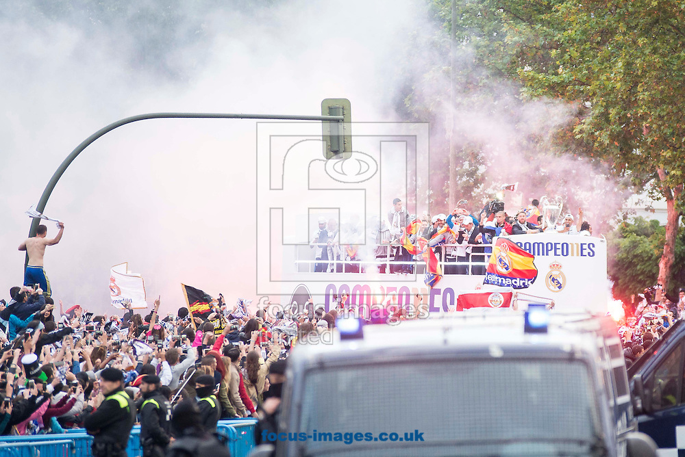 Real Madrid players celebrate winning the UEFA Champions League with an open top bus tour at Cibeles Square, Madrid<br /> Picture by EXPA Pictures/Focus Images Ltd 07814482222<br /> 29/05/2016<br /> ***UK &amp; IRELAND ONLY***<br /> EXPA-ESP-160529-0109.jpg