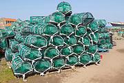 Piles of new lobster pots on Holy Island, Lindisfarne, Northumberland, England, UK