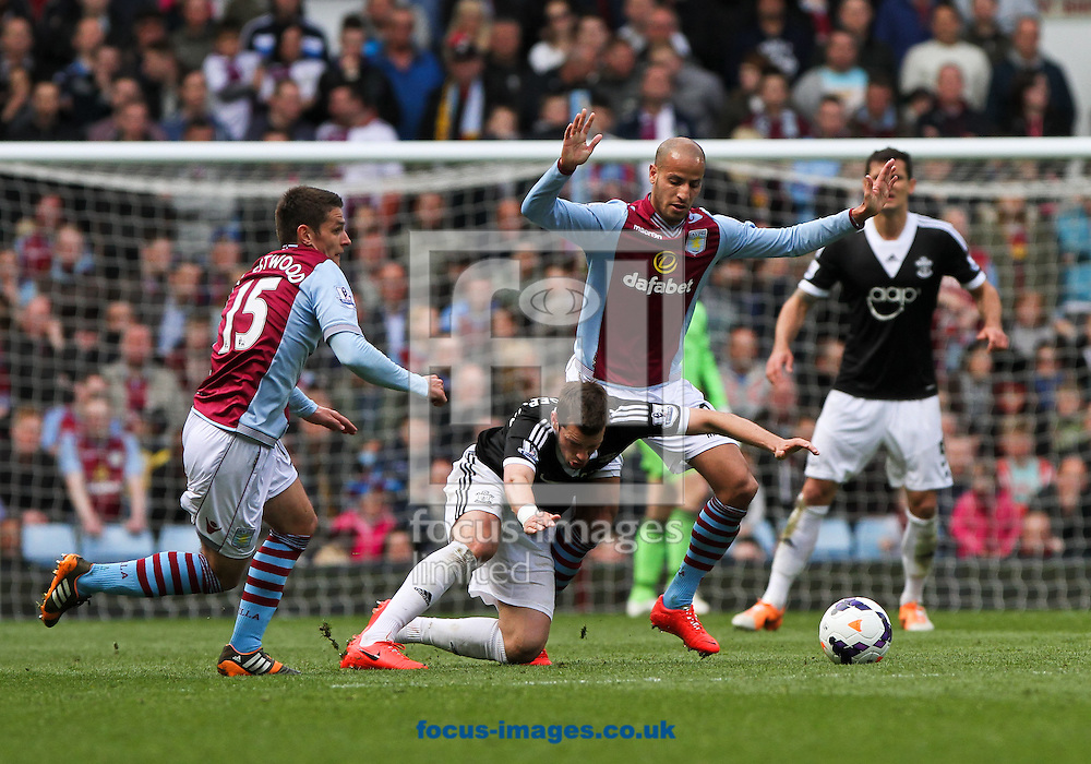 Karim El Ahmadi (centre right) of Aston Villa fouls Morgan Schneiderlin (centre left) of Southampton during the Barclays Premier League match at Villa Park, Birmingham<br /> Picture by Tom Smith/Focus Images Ltd 07545141164<br /> 19/04/2014
