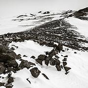 Wilson's Stone Igloo, Cape Crozier, Ross Island, Antarctica, with slopes of Mount Terror