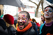 A young man participating in the carnival parade in Scampia laughs joyfully