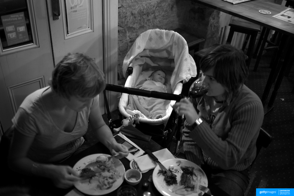 Jen and Jane enjoy an early evening out with baby Luca in Sydney, Australia on 31st March 2009. Photo by Tim Clayton.