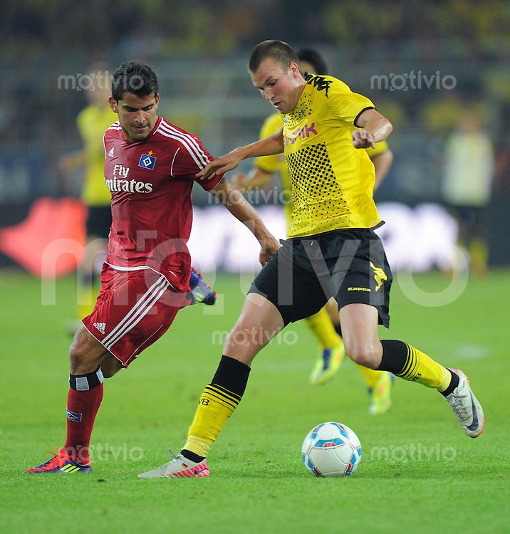 FUSSBALL   1. BUNDESLIGA  SAISON 2011/2012   1. Spieltag Borussia Dortmund - Hamburger SV                 05.08.2011 Tomas RINCON (li, Hamburg) gegen Kevin GROSSKREUTZ (re, Dortmund)