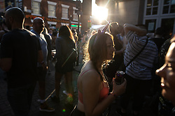 © Licensed to London News Pictures . 25/08/2019. Manchester, UK. People on Canal Street , as temperatures of over 30 degrees centigrade are recorded . Revellers in Manchester's Gay Village during the city's annual Gay Pride festival , which celebrates LGBTQ+ life and is the largest of its type in Europe . Photo credit: Joel Goodman/LNP