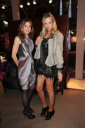 Left to right, KIM ROBSON ORTIZ and LISA HENREKSON at a party to celebrate the publication of Nathalie von Bismarck's book 'Invisible' held at Asprey, 167 New Bond Street, London on 9th December 2010.