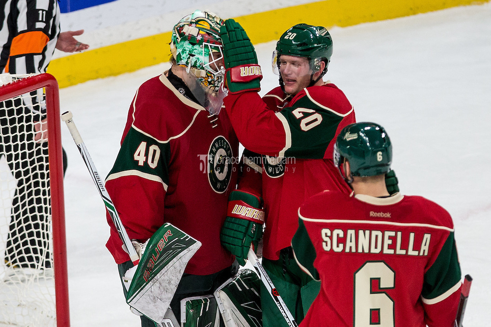 Dec 29, 2016; Saint Paul, MN, USA; Minnesota Wild defenseman Ryan Suter (20) celebrates with goalie Devan Dubnyk (40) following the game against the New York Islanders at Xcel Energy Center. The Wild defeated the Islanders 6-4. Mandatory Credit: Brace Hemmelgarn-USA TODAY Sports