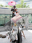 Around the World in 80 Days <br /> at The Scoop, More London, Great Britain <br /> press photocall<br /> 5th August 2011 <br /> <br /> Eugene Washington (as Phileas Fogg)<br /> Joseph Wicks (as Passepartout)<br /> <br /> <br /> <br /> Photograph by Elliott Franks
