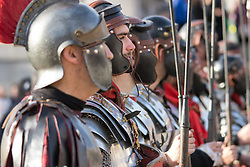 Trafalgar Square, London, March 25th 2016. Thousands of Londoners an tourists in Trafalgar Square are treated to The Passion of Jesus, a re-enactment of the events leading up to the crucifixion and resurrection of Jesus Christ. PICTURED: Roman soldiers look on as Jesus is tried. <br /> &copy;Paul Davey<br /> FOR LICENCING CONTACT: Paul Davey +44 (0) 7966 016 296 paul@pauldaveycreative.co.uk